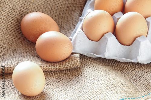 Pile of Brown fresh egg on brown fabric