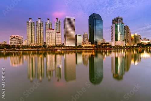 Foto op Plexiglas Stad gebouw Office building central business downtown with water reflection, cityscape background