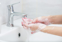 Washing Hands With Soap Under The Faucet With Water.