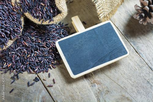 Brown rice, riceberry organic food in hemp sack with
