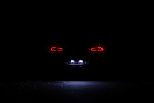 Led Tail Lights Of Modern Car At Night. Lights Of Licence Plate
