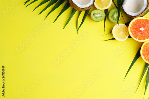 summer composition with exotic fruits and palm leaves on bright background. summertime vacation, cocktail, tropical beach. creative layout, banner or poster template with copy space for text design - 247120967