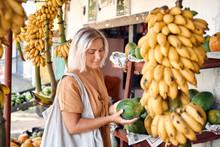 Woman Buy Fresh Papaya At Tropical Local Market