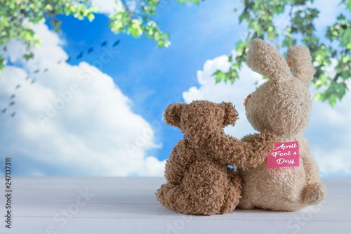 Fotografie, Obraz  Two friends of the toy bears are sitting on the boards against the background of