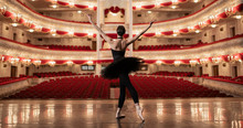 Ballerina Standing On Stage Of...