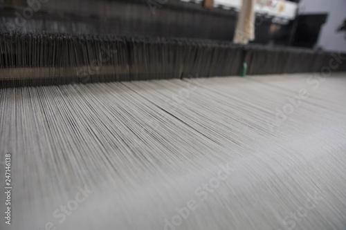 Yarn thread lines on the weaving loom machine Fototapeta