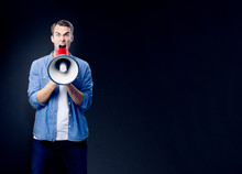 Man Shouting Through Megaphone