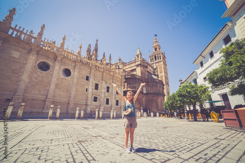 happy smiling girl tourist take photo selfie in Spain square (plaza de espana) in Sevilla, Spain