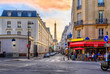 canvas print picture - Cozy street with tables of cafe in Paris, France. Architecture and landmark of Paris. Cozy Paris cityscape.