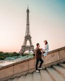 Fototapeta Fototapety z wieżą Eiffla - couple men and woman watching sunrise by eiffel tower paris, Eiffel tower Paris