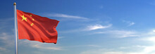 Flag Of China Rise Waving To The Wind With Sky In The Background