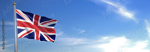 Flag of UK rise waving to the wind with sky in the background Canvas Print
