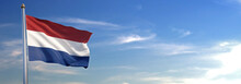 Flag Of Holland Rise Waving To The Wind With Sky In The Background