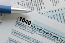 United States Federal Income Tax Return IRS 1040 Document With Blue Pen