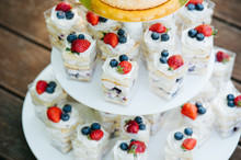 Yogurt Parfait With Strawberries On A Three Tier Cake Plate Stand.