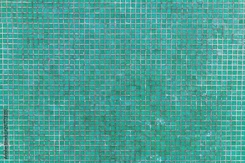 Fotografia  mur de petites briques en mosaique coloré