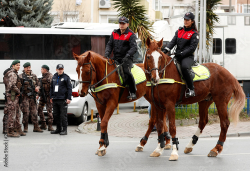 Police on horses patrol before a rally of the pro-Kurdish
