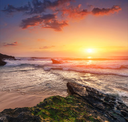 Fototapeta 3D Amazing sunset on the ocean. View of dramatic cloudy sky and stony coast. Portugal. Concept of the harmony with wildlife, romance, emotional experience in your soul, joy in mundane life.