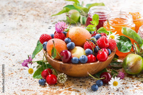 Obraz seasonal fruits and berries, jams, closeup - fototapety do salonu