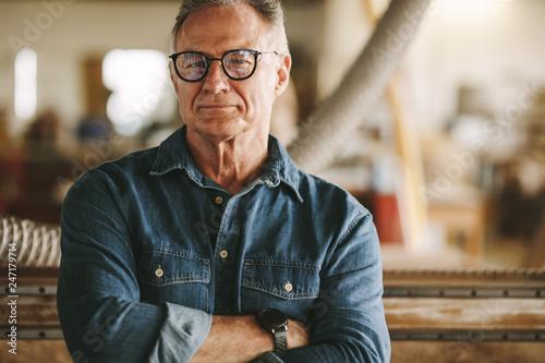 Fotografija Proud carpentry workshop owner