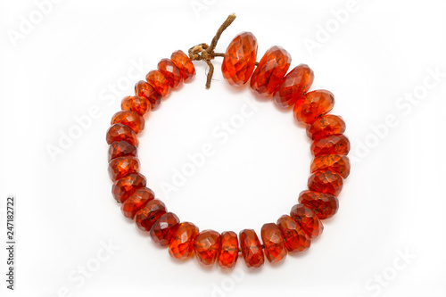 Very beautiful amber beads on a white background  Large