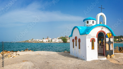 Fotobehang Europa Colorful greek orthodox chapel by the sea near Chania in Crete, Greece