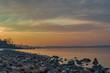 Rocky Baltic sea beach at sunset