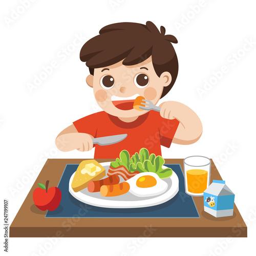 A little boy happy to eat breakfast in the morning. Slika na platnu