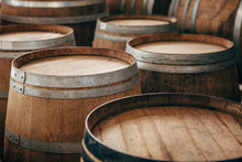 Old Wooden Wine Barrels With Iron Hoops.
