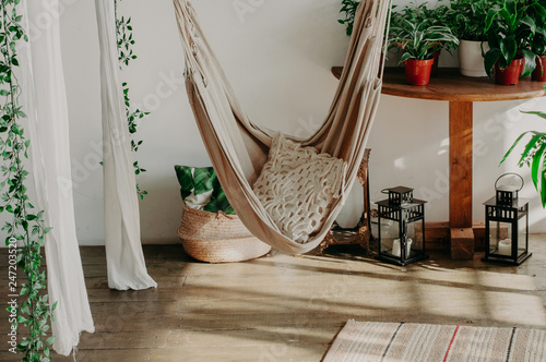 Fototapeta hammock in the minimalism bedroom interior. Pillows, plant