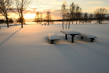 Snow Covered Table And Benches Outdoors