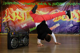 breakdance dancer in a unique pose on the elbow