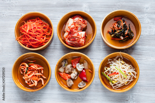 various side dishes in ceramic bowls on gray table