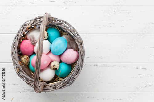 Easter eggs in basket Canvas Print