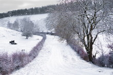 Yorkshire Wolds Road In Winter.  Snow Covered And Blocked Country Road High On The Yorkshire Wolds.