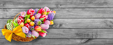 Springtime Flowers And Basket On Wooden Background