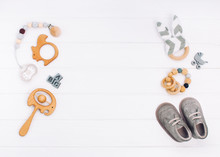 Baby Accessories On White Wooden Background