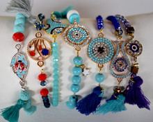 Close Up Of Beaded Bracelets On A White Surface
