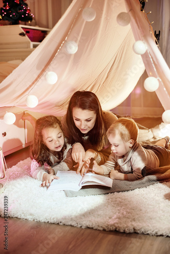 Poster Artist KB Young mother reading a novel with her kids