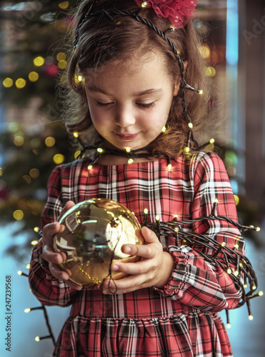 Poster Artist KB Cute child holding a christmas tree glass ball