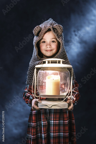 Poster Artist KB Conceptual portrait of a cute little girl holding a torch