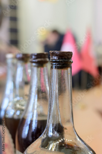 bottle Tincture alcohol propolis herbs glass on a rustic