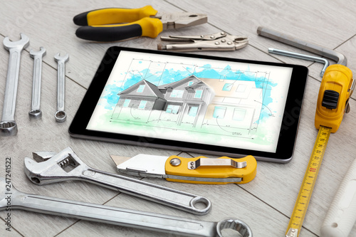 Poster Fleur Tablet with construction tools and house plan concept