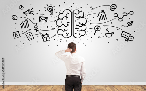 Fotografía Angry manager looking to wall with drawn overloaded brain concept