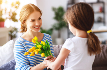 Obraz na Plexihappy mother's day! child daughter gives mother a bouquet of flowers to tulip and gift