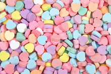 Background Of Brightly Colored Candy Hearts For Valentine's Day.