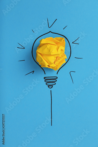Obraz Composition with crumpled paper ball and drawing of lamp bulb on color background, top view. Creative concept - fototapety do salonu