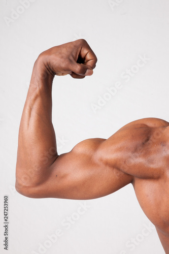 Fotografie, Tablou  Strong Black man flexing muscles
