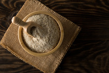 Heap Of Psyllium Husk Also Called Isabgol In Wooden Scoop And Bowl On Table Flat Lay From Above