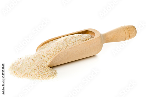 Fotomural Heap of psyllium husk also called isabgol in wooden scoop over white background